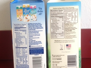 cartons of almond milk and cow's milk