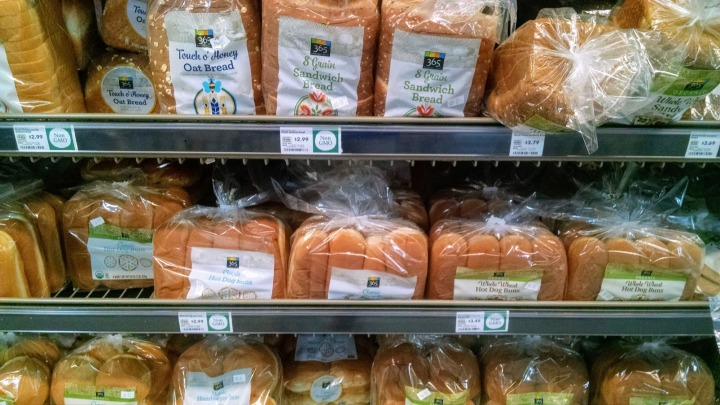 rows of multigrain breads and buns