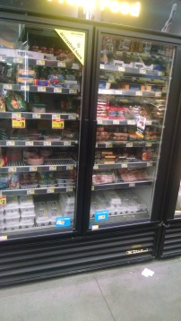 refrigerated foods in a display case