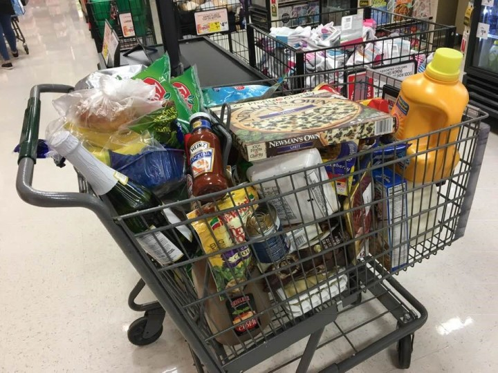 grocery cart full of foods and beverages