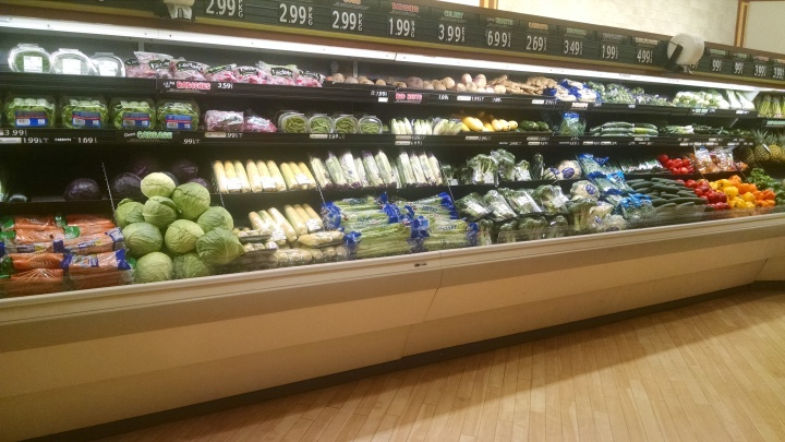 refrigerated display of fresh vegetables