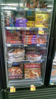 display case of frozen meals such as pizza and taquitos and