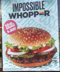 poster outside Burger King highlighting their Impossible Whopper