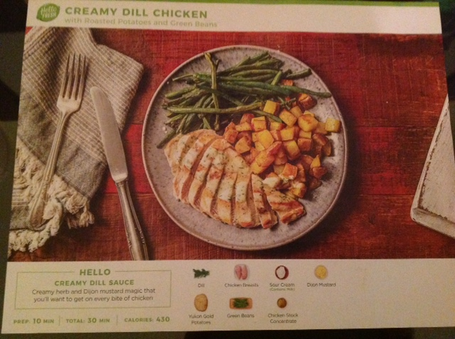 promotional material for a dish from a meal-kit featurening creamy dill chicken, asparagus and fried potato cubes