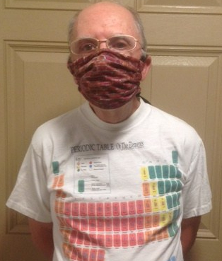 blogger dressed up with mask and wearing a shirt with the periodical table of elements