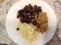 Plate of cauliflower, brown rice and beef tips