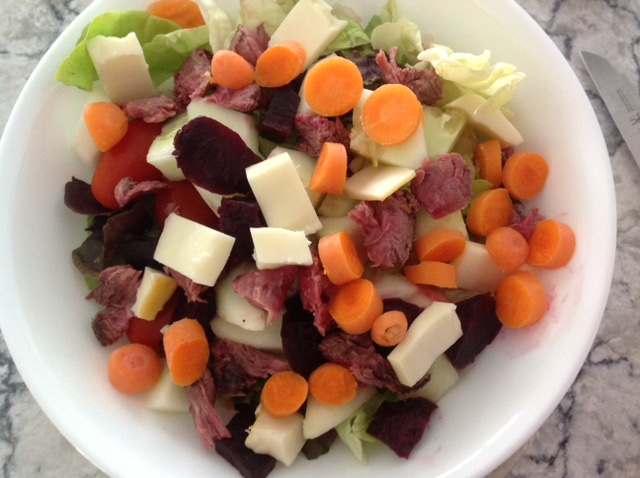 mixed salad of lettuce, carrots, cheese, sun-dried tomatoes and meat