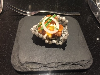 very fancy presentation of a dish prepared in at Meta in Singapore