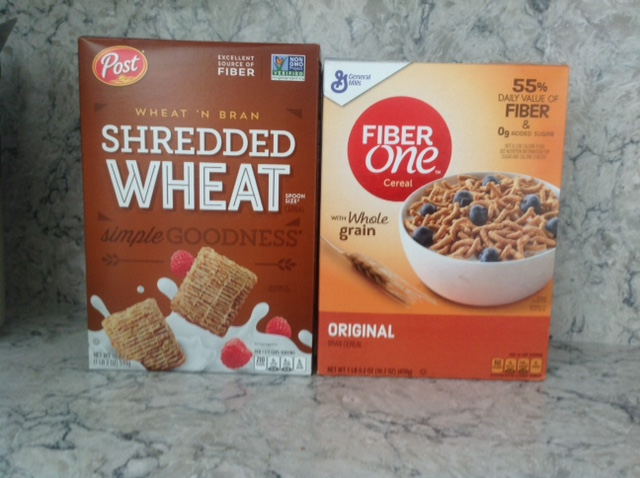 box of Shredded Wheat and a box of Fiber One breakfast cereals
