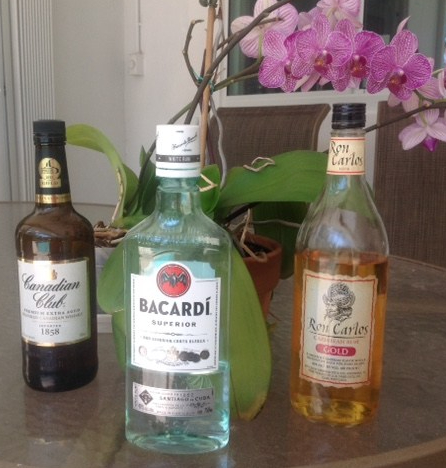 bottle of Canadian whiskey and two bottles of rum