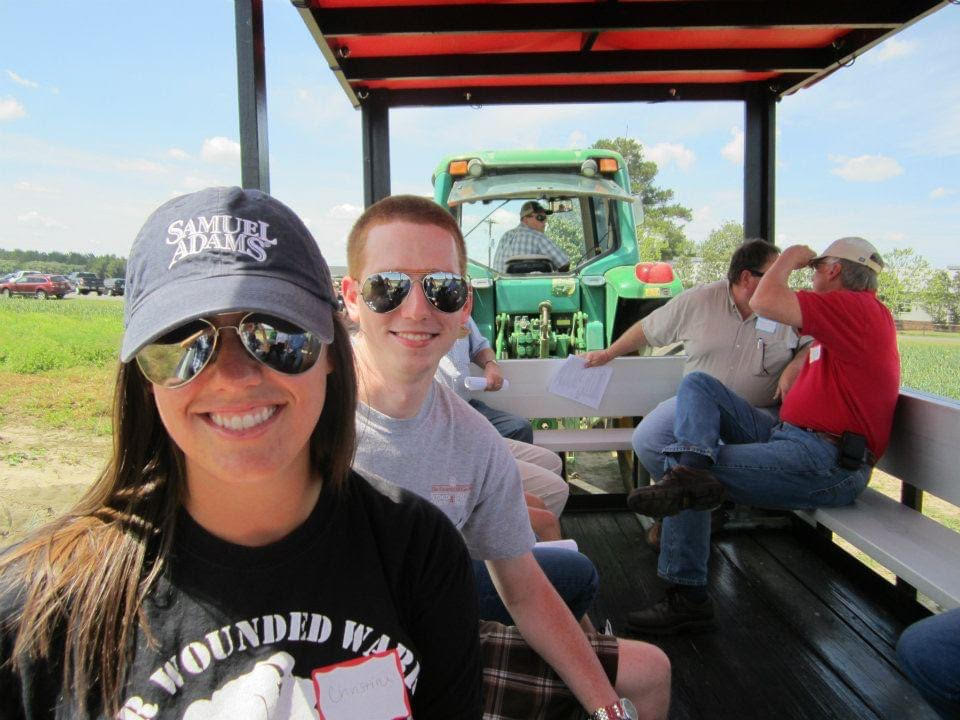 two students in a field transporter at a field day