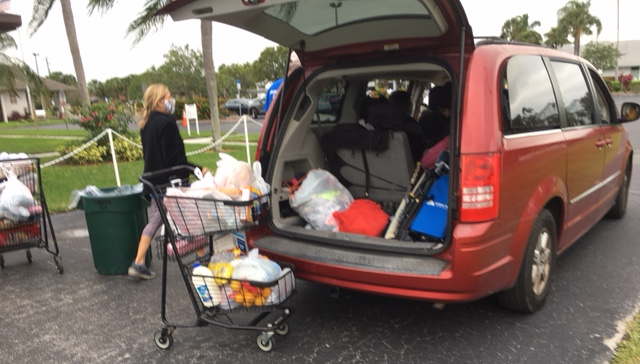 SUV with hatchback open prior to loading a basket full of food.