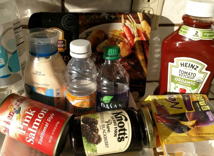 several food packages for water, ketchup, mayonnaise, canned salmon and blackberry jam