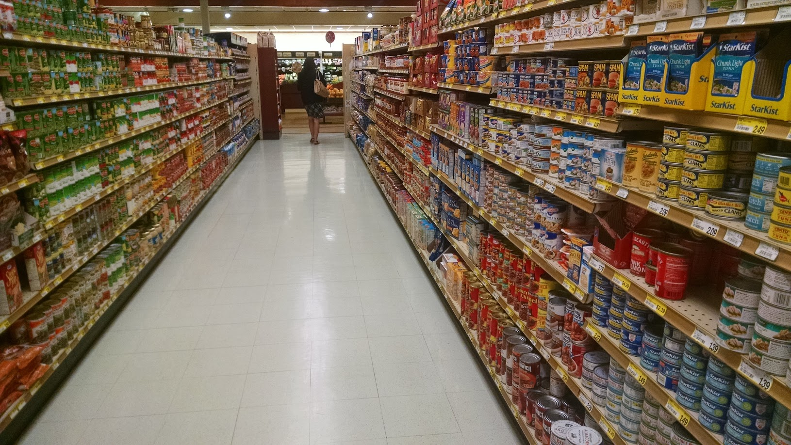 supermarket aisles with cann meats on the right and vegetable oils on the left
