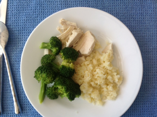 plate of roast chicken, broccoli and rice