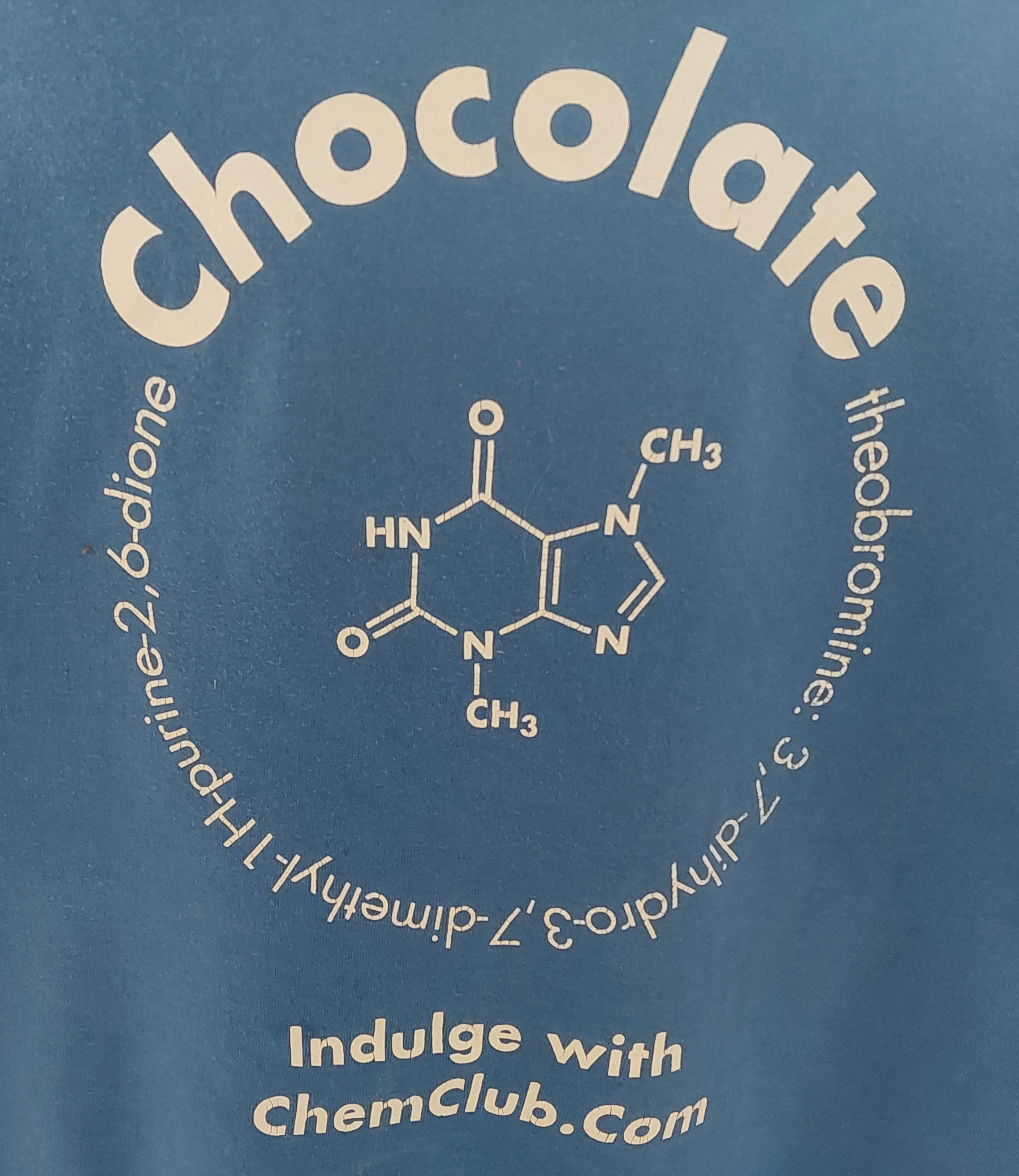 back of a tee-shirt with the structure of theobromine, a chemical in chocolate