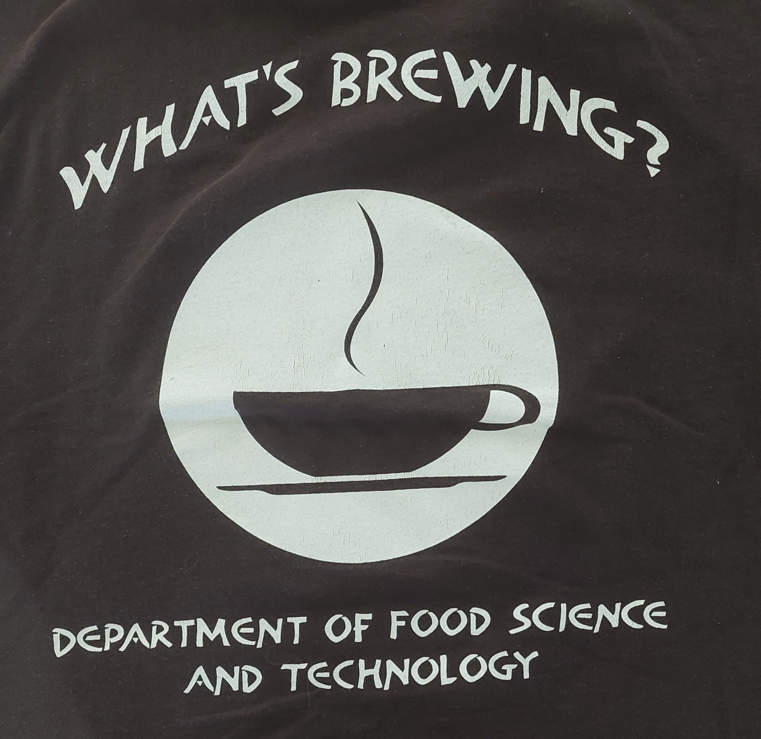 tee shirt with a warm cup of coffee asking What's brewing
