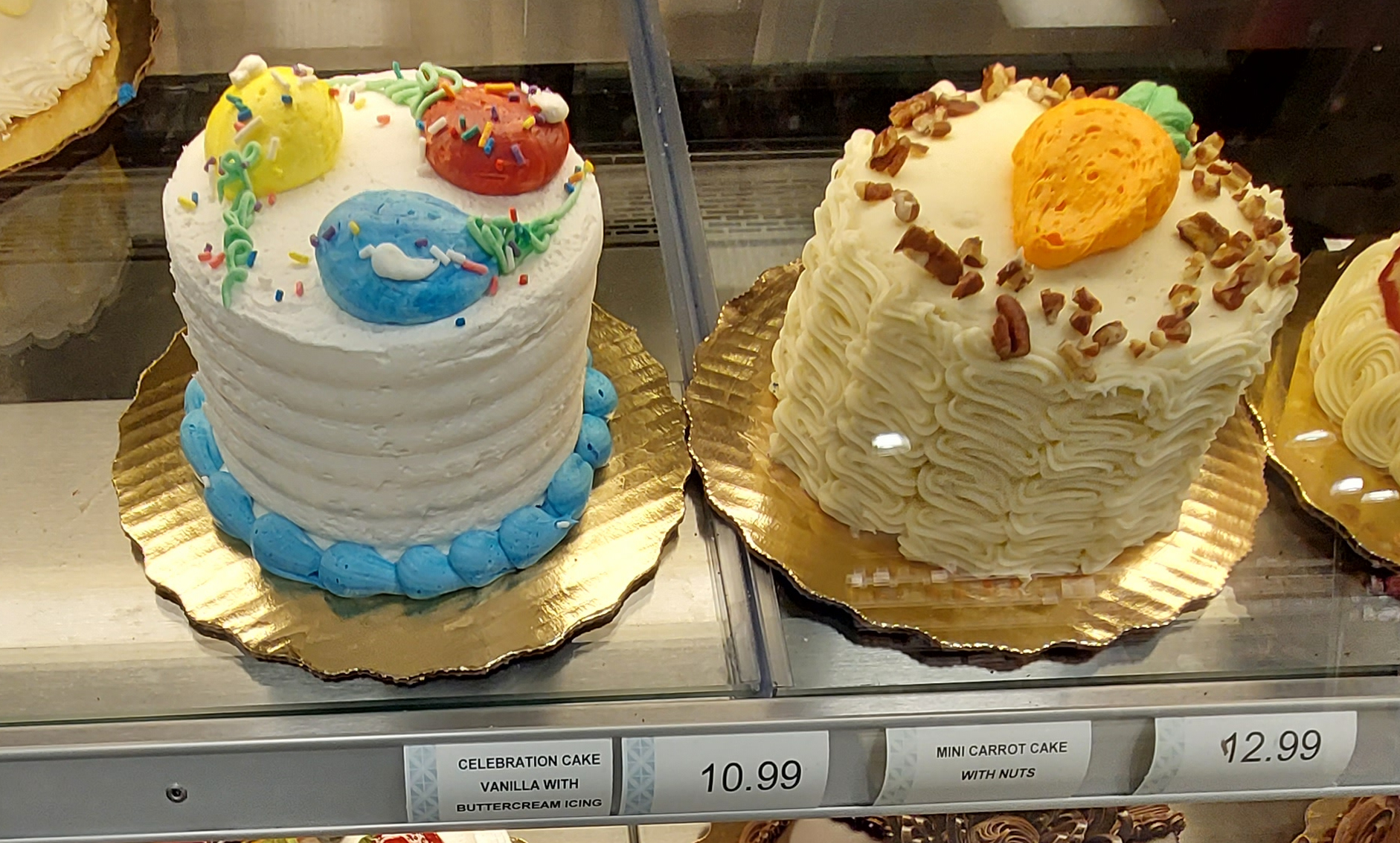 birthday cakes on display in a supermarket