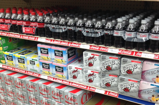 rows of diet and sugared sodas on a grocery store shelf